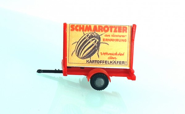 """HO: FG000042 Propagandaanhänger DDR Politparole """"Schmarotzer Kartoffelkäfer"""""""