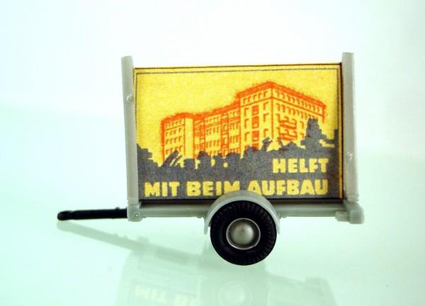 """HO: FG000029 Propagandaanhänger DDR Politparole """"Helft mit beim Aufbau"""""""