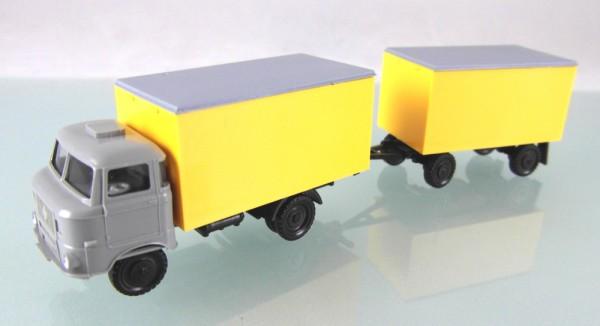 LKW W50L Kofferzug mit Glattwandkoffer neutral grau/gelb